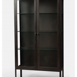 Four Hands - Trenton Cabinet - Treat your favorite contemporary setting to this simply impressive cabinet — ideal for displaying cherished collectibles. Clean-lined to be stately yet sleek, it's made of iron with an antiqued finish to let you store with style.