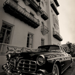 The Andy Moine Company LLC - 1955 Chrysler Imperial Flagger Hotel Fine Art Black and White Photography, 16x24 - Black and White Fine Art Photography captured with 35MM Ilford Film and reproduced in Limited Editions on Brushed Aluminum. This is a beautiful composition of a Mint Condition 1955 Chrysler Imperial with the Flagger Hotel in St Augustine, Florida in the Background.
