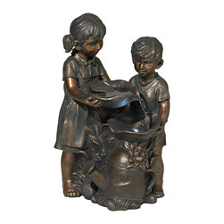 "Lamps Plus - Boy and Girl Indoor/Outdoor Bronze Fountain - A hardworking little boy and little girl are the center of this delightful indoor/outdoor fountain. The faces arms and legs of this little couple are in a warm polished bronze finish and while their clothing and bodies have a matte finish. Water flows down from bowls held by the children into a wonderful watering can thanks to an included recirculating pump. An LED accent adds illumination. Includes a convenient length of cord; simply add water plug in and enjoy! Lightweight polyresin construction. Polished and matte bronze finish. Includes recirculating pump and 9' cord. 23"" high. 14 1/2"" wide. 10 1/4"" deep.  Boy and Girl bronze finish fountain.  Built-in LED light.  Polished and matte bronze finish.  Lightweight polyresin construction.  Includes recirculating pump and a 9-foot cord..  23"" high.  14 1/2"" wide.  10 1/4"" deep."