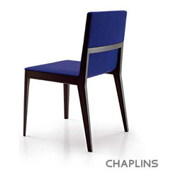 B&B Italia El Dining Chair - If you want a splash of bright blue in your dining room, these chairs may be the answer. They're a splurge, but the combination of comfort and unique style is outstanding. I'd pair them with deep, denim-blue walls for a truly enveloping blue room.