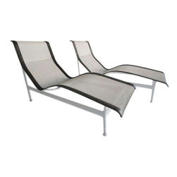 Knoll - Pre-owned Knoll Richard Schultz Outdoor Chaises - A Pair - A pair of outdoor chaise lounges designed by Richard Schultz for Knoll International. White nylon mesh seat with grey leather trim over an aluminum frame. This pair is in excellent condition, circa 1966, and ready for poolside entertaining!