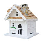 """Home Bazaar Inc. - Tranquility Feeder - White/Natural - Features: scalloped, roof line scrollwork; stone chimney with chimney cap; side bench; bay window; matching birdhouse decoration white peaked, pine shingled roof; storm shutters; trellis; white flower pot; lift-out, magnetic roof opening; and a pyramid-shaped center piece in the middle of the floor to spread seed to all four sides. Comes with a mounting plate that allows easy placement on a wooden 4"""" X 4"""" and an ingenious steel cable to hang the feeder."""