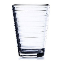 """Iittala - Iittala Aino Aalto Tumblers - Set of 2 - Clear - 11.75 oz - It seems no coincidence that Aalto means wave in Finnish. Aino Aalto (1894-1949) also caused waves with her glassware collection that beat her husband's entry in an iittala-Karhula design competition in Finland and went on to win the gold prize at the Milan Triennale in 1936. In the 1930's there were a lot of cheerfully useless objects floating around. Dinner services were vast and ornate, and kept in cupboards most of the year. Aino Aalto's radically simple design seemed as if it had arrived from the future. Not only did she use glass, but she also cleverly maximized the advantages of pressed-glass mass production techniques to create decoration out of the form and the material. An eloquent thought that explained how a more human and harmonious form of mass production could make design masterpieces available for everyone. In addition to the standard Aino Aalto colors, each year iittala chooses two additional colors for limited production, allowing for added accent pieces and combinability. Includes two tumblers Non-leaded crystal Dishwasher safe. Dimension: 4.5"""" H 11.75 oz. capacity"""