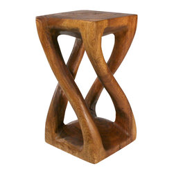 Strata Furniture - Vine Twist Table - The Vine Twist combines the graceful curves of the twist tables with four bold vine legs, all intricately carved from a single piece of Monkey Pod wood. It is not only functional, but doubles as a dramatic accent and conversational piece. This table, measuring 23 inches high and 12-by-12 inches in width, is finished in eco-friendly Livos Black Walnut Oil, with light and dark variations throughout the piece. As with all natural exotic wood products there will be some slight variation in color, texture, and finish color. There will be various separations or cracks on your piece when it arrives - these naturally occurred as the wood was dried and shrank. These variations do not compromise the structural performance or integrity of the wood and are considered inherent to the natural beauty of the design. These variations are not considered flaws and not acceptable reasons for returns. (Double twist does not come as a pair - only one included in price.)