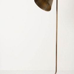 Gilded Glow Floor Lamp - Anthropologie.com - The lines of this brass lamp are amazing. It looks like a work of art.