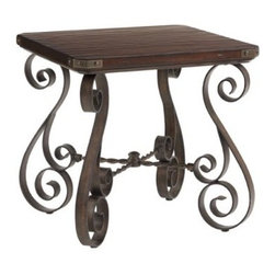 Lexington Home Brands Fieldale Lodge Littleton Square End Table - Quality grace and style are the hallmarks of the Lexington Home Fieldale Lodge Littleton Square End Table. The scrolled iron base gives a classic European feeling to the piece while the hand-hewn wood top sits gracefully above. Sturdiness and charm are what give this gorgeous table style beyond compare. About Lexington Home Brands Founded in 1903 in High Point NC; Lexington Home Brands has become a globally known manufacturer and marketer of unique home furnishings. They are an industry leader in design style and quality products. Their product line consists of upholstered and hardwood furniture under recognized brands such as Lexington Tommy Bahama Sligh and Henry Link Trading Co. Lexington Home Brand's intentions and aspirations are to create exclusive designs and styles that accommodate the traditional contemporary casual and formal decors of their customers' homes.
