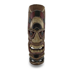 Zeckos - Hand Carved Island Tiki Mask Wall Hanging Bar Patio - Made in Indonesia, this tiki mask wall hanging is hand-carved from dark Albesia wood. Measuring 20 inches tall, 6 inches wide and 2 1/2 inches deep, it looks great on walls in patios, outdoor tiki bars or any other Polynesian themed room. It is hand-painted with red , green and black paints, and accented with hundreds of tiny painted white dots. This wall mask makes a great gift for friends and family. note: Since these masks are hand carved, there may be slight color or facial differences from the pictures. These won't last long, so get yours now