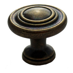 GlideRite - GlideRite 1.25-inch Antique Brass Classic 3-ring Round Cabinet Knobs (Pack of 25 - Update your kitchen cabinets or bathroom vanities with these beautiful solid die-cast zinc alloy antique brass 3-ring round cabinet,dresser or drawer knobs. Each knob is individually bagged to prevent damage to the finish.