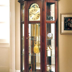 "Ridgeway Clocks - Canted End Curio Clock with Glass Access Pane - This beautiful curio clock is at once attractive and useful, since it is able to not only tell the time but display your possessions as well. The central pendulum and weights swing freely beneath the dial, which features a polished brass finish. Two shelves and two adjustable glass sheets give ample storage space to the unit. * This canted end curio clock with swan neck pediment features glassaccess panels, allowing full view of the clock's movement.. The lighted top section has two glass shelves as well as two adjustableshelves in the pendulum area.. A mirrored back case adds sparkle to anydisplay.. Antique Cherry finish on select hardwoods and cherry veneerscompliment a polished brass finished dial with black Roman numeralsand stationary astrological moon dial.. A harp pendulum with 6 1/2"" (165mm) polished brass disk and polishedbrass weight shells, bring this chain driven movement with Westminsterchime to life.. The front door comes with a lock for added security.. H 77""(196cm), W 41""(104cm), D 11""(28cm)"