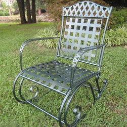 International Caravan - Milano Rocker in Wrought Iron w Verdigris Fin - Take the next step into bold, innovative design accents with this outdoor rocker from the Milano collection. The chair boasts an impressive array of features, including sturdy iron construction, weatherproof protection, grid seat and back, curved armrests and a unique verdigris finish. In verdigris finish. Made of iron. Uses EP protection. Smooth scroll-work. 26 in. W x 34 in. D x 38 in. H