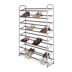 Whitmor - Silver Epoxy Metal Shoe Tower - Keep your shoes neatly stacked and ready to wear with this metal shoe tower. Made with durable silver epoxy coated metal side frames and 8 tiered black nonslip tubes it holds up to 40 pairs of shoes. With so much space you'll never need to line a closet or bedroom floor with piles of shoes again. Using the rack keeps scuffs and scratches at bay and helps keep your shoes from getting crushed.