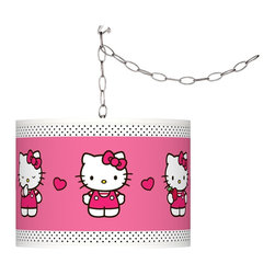 "Hello Kitty - Kids Hello Kitty Pink and Polka Dots 13 1/2""W Swag Pendant - Add a cheerful accent to your home décor with this Hello Kitty Pink and Polka Dots swag plug-in pendant light. Officially licensed from Sanrio the design brings the iconic Hello Kitty to life on a Giclee Glow drum shade custom-printed on high-quality translucent fabric. Comes with a brushed silver finish spider fitting chain and silver cord. Simply hang the cord on the included hooks drape as desired then plug in to any outlet. U.S. Patent # 7347593. Officially licensed design from Sanrio. Brushed silver swag plug-in chandelier. Hello Kitty Pink and Polka Dots pattern Giclee Glow shade. Translucent fabric lets light shine through. Maximum 100 watt bulb (not included). In-line on/off switch. Includes swag hooks and mounting hardware. Shade is 13 1/2"" wide 10"" high. Includes 15' wire 10 feet chain. May only ship to the United States its territories possessions and the Commonwealth of Puerto Rico. ©1976 2013 Sanrio Co. Ltd. Used under license.  Officially licensed design from Sanrio.   Brushed silver swag plug-in chandelier.   Hello Kitty Pink and Polka Dots pattern Giclee Glow shade.   Translucent fabric lets light shine through.   Maximum 100 watt bulb (not included).   In-line on/off switch.   Includes swag hooks and mounting hardware.   Shade is 13 1/2"" wide 10"" high.   Includes 15' wire 10 feet chain.   May only ship to the United States its territories possessions and the Commonwealth of Puerto Rico.  ©1976 2013 Sanrio Co. Ltd. Used under license."