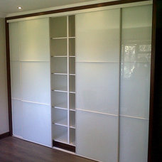 Contemporary Storage Units And Cabinets by JV Interiors