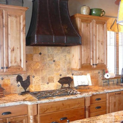 "Country Kitchen - Venetian Oil Rubbed Bronze Range Hood #13 by Texas Lightsmith. Travertine back-splash. Oil rubbed bronze faucet and custom prep sink, natural unstained wood. Kitchen Design by ""Interiors Plus Design"""