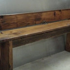 Rustic Barnwood Bench by Dark Creek Design - This rustic modern bench was made with a barn door and its original hinges. It reminds me of a church pew. I could picture it in an entryway as a standout seat.
