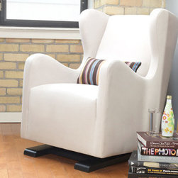 Monte Vola Glider - This fresh take on the wingback chair is sleek and modern, plus it looks super comfy and supportive - just what you need during those late-night feedings. Bonus: it's crafted by hand, eco-friendly, and sustainable. If I could do over my home nursery with an unlimited budget, this glider would be at the top of my list!