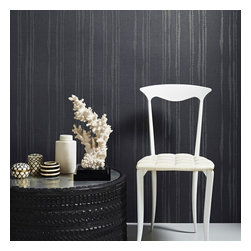 Graham & Brown - Laddered Stripe Wallpaper - This organic striped wallpaper is highlighted with metallic detail to the stria that really catches the light so if you want to create a moody look go for a darker palette or to add light to a darker room, this midnight colourway would be perfect for creating a certain mood. This design co ordinates perfectly with the linen texture design so you can create your perfect look.
