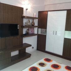 Asian Living Room by Vastu Homedecor