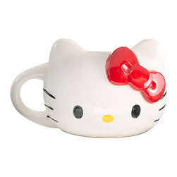 Hello Kitty - Hello Kitty Head Mug - Say hello to a new morning with this adorable Hello Kitty-shaped mug! Careful crafting recreates the precious girl's head and iconic bow, making it a supersweet way to sip morning coffee or afternoon tea.   6.5'' W x 4'' H x 4.75'' D Ceramic Hand wash Imported