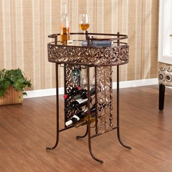 Southern Enterprises Dovaz Metal Wine Table - Proudly display your fine wine collection with the Southern Enterprises Dovaz Metal Wine Table. Ornate and decorative with lazer-cut leaves to display a vinyard like theme. All metal construction with an oil-rubbed bronze finish. The base is a wine bottle rack to hold up to 9 bottles. Added feature of a built in stemware rack to keep your wine glasses handy for entertaining. The oval top is a glass shelf with 5mm tempered glass great for displaying ornamental glassware. Some assembly required. Product dimensions: Table top dimensions: 24W x 14.5D x 2.5H inches Hanging racks: 14.25 in. depth Bottle holders: 4 in. Diameter Space beneath table: 6H inches Max weight capacity: 50 lbs 5 lb. per bottle holder Overall table dimensions: 25.25W x 16D x 35.5H inches About SEI (Southern Enterprises Inc.)This item is manufactured by Southern Enterprises or SEI. Southern Enterprises is a wholesale furniture accessory import company based in Dallas Texas. Founded in 1976 SEI offers innovative designs exceptional customer service and fast shipping from its main Dallas location. It provides quality products ranging from dinettes to home office and more. SEI is constantly evolving processes to ensure that you receive top-quality furniture with easy-to-follow instruction sheets. SEI stands behind its products and service with utmost confidence.