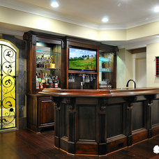 Traditional Basement by White Oak Renovations