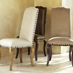 Calais Chair - These chairs (in any color) would be perfect with a classic wood dining table. They look comfy, have a classy nailhead trim and have great legs.