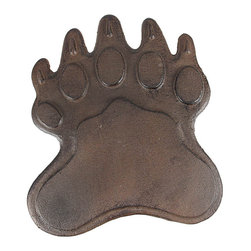 Cast Iron Bear Footprint Garden Stepping Stone - This cast iron bear footprint garden stepping stone is a great addition to gardens, flower beds and patios. The footprint measures 10 inches by 8 1/2 inches, and is 1/4 of an inch high. It has a distressed brown enamel finish that gives it an aged, rusty look. It won`t crack or chip like resin or stone steps stones, so it`s great for areas that freeze in winter. Buy multiples to create pathways in your garden, or use a single one between your patio and lawn as a decor piece.