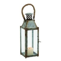 """Benzara - Gorgeously Styled Metal Glass Lantern - Cast a warm spell in your ambiance, with this lantern that is crafted of sturdy metal and glass. This lantern has rust accents that give a vintage touch to the dwelling. The curved rope handle at the top helps you hook the lantern easily to any wall in the house. Also, carrying the lantern is an easy task with such a comfortable handle. Apart from using this lantern for indoor, purpose, it can also be used outdoors. Add it to the lawn or patio to spend a warm evening.The glow of the candle light inside the lantern will not only spread brightness but will create a soothing ambiance. Carry this lantern along while you are travelling as it is indeed of good use whole camping and trekking. You must have never before seen such a traditional looking lantern as this is just one of its kinds. So, get one for your use!. This glass lantern measures 6 inches (width) X 6 inches (L) X 17 inches (Height) ; Curved rope handle; Metal construction with rustic accents; Dimensions: 15""""L x 3""""W x 17""""H"""