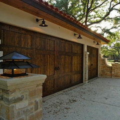 mediterranean garage and shed by Stadler Custom Homes