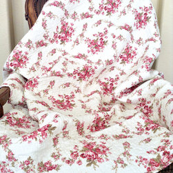 None - Chic Vintage Rose Quilted Throw - Bring the loveliest of the outdoors into the bedroom with this rose quilted throw. The soft cotton throw showcases an intricate quilting that provides a rich surface texture.