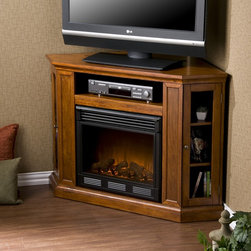 Holly and Martin™ Ponoma Convertible Media Electric Fireplace - Mahogany - For the entertainment enthusiasts, this mahogany glazed fireplace accommodates wonderfully. Triangular media storage shelves on either side of the firebox provide plenty of space for your favorite media selections and are enclosed by glass doors. An additional media equipment shelf rests above the firebox and is complete with convenient back wall cord access. This particular fireplace mantel is also designed with a collapsible panel, allowing for versatile placement against a flat wall or corner in your home.