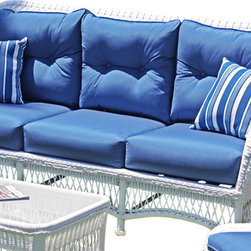 Wicker Paradise - Princeton Wicker Sofa - White - Lazy summer afternoons are a lot more relaxing when you have a sofa like this one. The classic lines and white color give this sofa a contemporary charm that works in a historic home or a modern-day cottage.  It is made of resin wicker and built on an aluminum frame for total outdoor use. The Princeton sofa comes with bottom and back cushions in Sunbrella Sapphire Blue fabric. Throw pillows are not included.