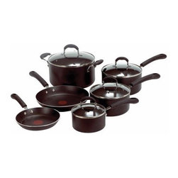 "T-fal - Professional Stainless Steel 10-Piece Cookware Set - If you are more than a casual chef, then the Professional10-piece Cookware Set is for you. It is ready to handle anything you can throw at it or in it! Features: -Thermo spot hot indicator tells you when the pan is pre-heated to start cooking.-Non-stick exterior.-Stainless steel disc base provides superior heat distribution and maximum anti-warping projection.-Expert non-stick cooking surface.-Silicone handles that are ergonomically designed.-Dishwasher safe.-8'' Frying pan.-10.25'' Frying pan.-1-Quart covered sauce pan.-2-Quart covered sauce pan.-3-Quart covered sauce pan.-5-Quart dutch oven.-Sleek black finish.-Collection: Professional.-Color: Black.-Distressed: No.-Powder Coated Finish: Yes.-Gloss Finish: Yes.-Material: Aluminum.-Base Material: Stainless Steel.-Number of Items Included: 10.-Non Toxic: Yes.-Scratch Resistant: Yes.-Rust Resistant: Yes.-Warp Resistant: Yes.-Chip Resistant: Yes.-Tarnish Resistant: Yes.-Stain Resistant: Yes.-Peel Resistant: Yes.-Nonreactive: No.-Non-Stick Surface: Yes.-Construction: 2-ply.-Oven Safe: Yes.-Freezer Safe: No.-Microwave Safe: No.-Dishwasher Safe: Yes.-Maximum Temperature: 350 degrees.-Stove Safe: Yes -Stove Type Compatability: Gas;Electric;Glass..-Lids Included: Yes -Number of Lids: 4.-Lid Handle: Yes.-Lid Material: Glass.-Heat Resistant Lids: 350 degrees.-Air Vents: Yes..-Handles: Yes -Handle Material: Silicon.-Handle Finish: Black.-Non-Slip Handle: Yes.-Heat Resistant Handles: 350 degrees..-Nesting: Yes.-Outdoor Use: No.-Pouring Rims: No.-Hanging: Yes.-Commercial Use: Yes.-Recycled Content: No.-Eco-Friendly: No.Specifications: -PTFE Free: Yes.-PFOA Free: Yes.Dimensions: -Skillets Overall Width - Side to Side: 10.25"".-Skillets Overall Depth - Front to Back: 10.25"".-Overall Product Weight: 17.5 lbs.Assembly: -Assembly Required: No.Warranty: -Limited lifetime warranty.-Product Warranty: Limited lifetime warranty."