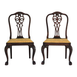"""Consigned Pair of George II Style Side Chairs - Exquisite pair of Georgian-style antique side chairs, circa mid-19th century. The uniquely arched backs are adorned with an intricately carved shell on the top rail. The prominent knees are magnificently carved with bell flowers and scrolls ending in ball and claw feet. The drop-in seats are covered in new wreath and bumblebee goldenrod fabric and are firmly secured to the frame. Seat, 18""""H."""
