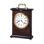 "Howard Miller - Walnut Finished Mantel Clock with Brass Butto - An attractive walnut finish and brass accents and designs give this clock a warm feeling, perfect for placement in any setting. The wood is textured with a wood burl pattern on the front and back, to give the piece an artistic feeling. The roman numeral clock face is circled with a polished brass finish. * An attractive high-gloss walnut piano finish on a hardwood bracket style table clock featuring a wood burl pattern on the front and back, with black sides, top and base. Polished brass button feet. . Polished brass tone waterfall bezel and glass crystal. Off-white dial offers black Roman numerals, black hour and minute hands, with a brass second hand. . Case is sealed on all sides. Designed for the entire dial to be removed to replace the batteries and change the time. Quartz movement includes battery. . H. 8-1/4"" (21 cm). W. 5-1/4"" (13 cm). D. 2"" (5 cm)"