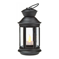 Black Hurricane Candle Lanterns - Illuminate your backyard with fire and candlelight to create a beautiful setting for hosting an outdoor party.