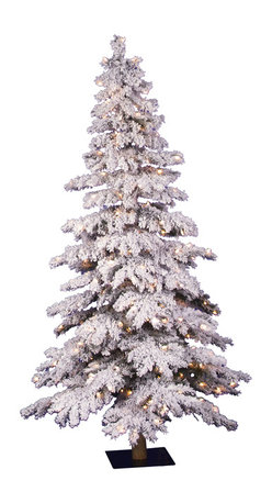 Flocked Spruce Christmas Tree - Showcasing a heavily flocked look, our Spruce Christmas tree brings the beauty of winter into your home. The round, faux bark trunk of this flocked Christmas tree echoes the traditional alpine tree look. Even when undecorated, our Spruce Christmas tree is a lovely vision as the clear pre-strung lights twinkle from within the white branches.