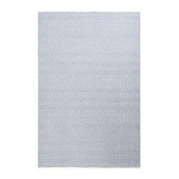 Escape Sky Indoor/Outdoor Rug - 8' x 10' - Refined yet playful, the pattern of the Escape Sky Indoor-Outdoor Rug is vibrant even in its dreamy, low-key pastel blue and white palette. Fine lines leap and angle over the surface for an active and moving look. Not only is the rug remarkably durable and easy to care for with its low-profile flat weave and manmade fiber content; it's even reversible to extend its life.