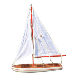 Handcrafted Nautical Decor - It Floats Red 21'' - White Sails - Floating Sailboat - Wood Ship Model - Yacht - NOT A MODEL SHIP KIT--Attach Sails and the It Floats Sailboat is Ready for Immediate Display -- --Our new It Floats Red 21'' - White Sails model salboat    is freshly designed with increased craftsmanship and is our debut   float alone sailboat. Available in 9 different styles, this sailboat can   be taken into the water and enjoyed by anyone. Included with your   purchase is a wooden base to prominently display the model after use.   These sleek and elegant wooden  model sailboats have seen careful   attention paid to every detail. Bring a  winning spirit and nautical   flair to the Decor of any room with the  clean lines and graceful   features of these model sailing boats. ------    Handcrafted from solid wood by our master artisians--    Wooden base included with sailboat to prominently display model--    Our debut floating sailboat is waterproof. IT FLOATS!--    Suits any room or decor with clean lines and simple colors--    All rigging, lines and stays       feature brass hooks which attach into eyelets on mast, boom, bowsprit or       deck--    Ready to display in less than       five minutes--