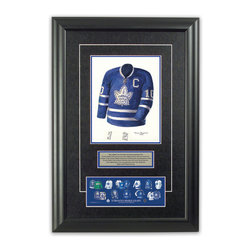 "Heritage Sports Art - Original art of the NHL 1963-64 Toronto Maple Leafs jersey - This beautifully framed piece features an original piece of watercolor artwork glass-framed in an attractive two inch wide black resin frame with a double mat. The outer dimensions of the framed piece are approximately 17"" wide x 24.5"" high, although the exact size will vary according to the size of the original piece of art. At the core of the framed piece is the actual piece of original artwork as painted by the artist on textured 100% rag, water-marked watercolor paper. In many cases the original artwork has handwritten notes in pencil from the artist. Simply put, this is beautiful, one-of-a-kind artwork. The outer mat is a rich textured black acid-free mat with a decorative inset white v-groove, while the inner mat is a complimentary colored acid-free mat reflecting one of the team's primary colors. The image of this framed piece shows the mat color that we use (Medium Blue). Beneath the artwork is a silver plate with black text describing the original artwork. The text for this piece will read: This original, one-of-a-kind watercolor painting of the 1963-64 Toronto Maple Leafs jersey is the original artwork that was used in the creation of this Toronto Maple Leafs uniform evolution print and tens of thousands of other Toronto Maple Leafs products that have been sold across North America. This original piece of art was painted by artist Tino Paolini for Maple Leaf Productions Ltd.  1963-64 was a Stanley Cup winning season for the Toronto Maple Leafs. Beneath the silver plate is a 3"" x 9"" reproduction of a well known, best-selling print that celebrates the history of the team. The print beautifully illustrates the chronological evolution of the team's uniform and shows you how the original art was used in the creation of this print. If you look closely, you will see that the print features the actual artwork being offered for sale. The piece is framed with an extremely high quality framing glass. We have used this glass style for many years with excellent results. We package every piece very carefully in a double layer of bubble wrap and a rigid double-wall cardboard package to avoid breakage at any point during the shipping process, but if damage does occur, we will gladly repair, replace or refund. Please note that all of our products come with a 90 day 100% satisfaction guarantee. Each framed piece also comes with a two page letter signed by Scott Sillcox describing the history behind the art. If there was an extra-special story about your piece of art, that story will be included in the letter. When you receive your framed piece, you should find the letter lightly attached to the front of the framed piece. If you have any questions, at any time, about the actual artwork or about any of the artist's handwritten notes on the artwork, I would love to tell you about them. After placing your order, please click the ""Contact Seller"" button to message me and I will tell you everything I can about your original piece of art. The artists and I spent well over ten years of our lives creating these pieces of original artwork, and in many cases there are stories I can tell you about your actual piece of artwork that might add an extra element of interest in your one-of-a-kind purchase."
