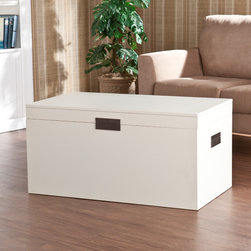 Upton Home - Barclay White Trunk Cocktail Table - The trunk table features a lovely, painted white finish and simple, squared design, the handles fold flat to the sides, keeping the linear design continuous. The trunk lid lifts to reveal a large storage area for pillows, blankets, and other daily items.