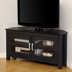 Compton Black Corner TV Stand - Add style and function to your living space with the Compton Corner TV Stand in Black. This contemporary stand is crafted from high-grade MDF and PVC laminate and finished in textured black. It holds up to a 52-inch TV and features enclosed shelving with ample space for AV components. Its corner design saves space and keeps your TV the focal point. For easy assembly all necessary tools and instructions are included as well as a toll-free assistance number and online support. About Walker EdisonWalker Edison distinguishes itself as a maker of fine TV stands entertainment centers coffee tables dining tables and desks. Constructed of quality materials using careful methods Walker Edison's pieces are superior in durability and style yet affordable in price. Their factories are located across the world and are staffed by skilled artisans while materials are supplied from low-cost local raw goods to help keep prices low. Trust your home furniture needs to Walker Edison.