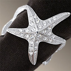L'Objet Starfish Platinum Swarovski Napkins Rings - Beach themed table settings don't always have to be casual.  These little Starfish Platinum Napkin Rings would set a most elegant beach themed table.  Use dark colored napkins to contrast with the beautiful crystals.