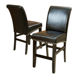 Great Deal Furniture - Clifton Black Leather Counter Stools (Set of 2) - The Clifton leather counter stool is great for your kitchen, bar or dining space. It is upholstered in beautiful, soft black bonded leather, and its seat is embellished with chrome nailhead accents and a dark metal kick-plate. You will enjoy the look and feel of this stool.