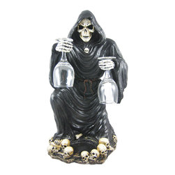 Gothic Grim Reaper Wine / Liquor Valet Holder - Made of cold cast resin, this wickedly evil Grim Reaper wine or liquor bottle holder is the perfect for accent to any Gothic themed room. Measuring 19 inches tall, 10 inches wide and 11 inches deep, the reaper holds 2 wine glasses in his bony hands, and his robe envelops your favorite bottle of wine, liquor or apertif. He`ll make a great addition to your home bar. We have a limited supply of these, so don`t miss out. Get yours now!