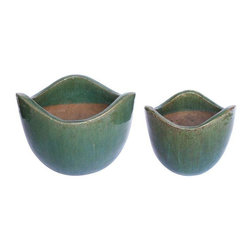 "Used 1950's Green Glaze Pottery - Set of 2 - Gorgeous vintage pottery set, handmade in the 1950's. Coated in a beautiful green glaze on exterior and lip, while the original clay was left exposed on bottom and interior. Would make wonderful planters either inside or in the garden.    Small - 9""W x 9""D x 7.5""H  Large - 12.5""W x 9.5""D x 10""H"