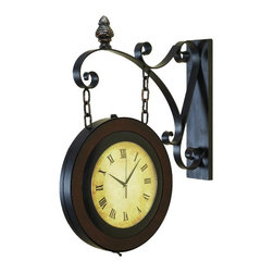Aspire - 27 in. Train Station Wall Clock - This train station wall clock features a heavy metal frame from which hangs the two sided roman numeral clock face. Finished in tones of dark brown. Metal. Color/Finish: Brown. Operates using two AA batteries (not included). The clock portion measures 15 inches in diameter. 27 in. H x 22 in. W x 4 in. D. Weight: 16.5 lbs.