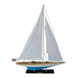 Handcrafted Nautical Decor - Sovereign Limited 27'' - NOT A MODEL SHIP KIT--Attach Sails and Sovereign model yachts are Ready for Immediate Display ----Newly redesigned, our Limited Edition sailing ship models of the famous America's Cup challenger Sovereign feature significantly upgraded deck features and increased craftsmanship. Still actively sailing and racing today, Sovereign will take you away with the wind and waves in these Limited Edition model yachts. Perfectly sized for any bedroom shelf, sunroom mantle or office desk, this high-quality yacht model is adorned with finely-crafted features and graceful lines. --20'' L x 4'' W x 27'' H  (1:78 scale)----    Accurate      museum-quality scale replica of the real      Sovereign racing yacht--    Individual plank      on frame      construction of the hull using fine quality woods, with each plank and      wood grain visible through the paint--    High quality Craftsmanship and Details over 20'' model sailing ship,      including:--    --        Higher quality woods used in       construction of hull and deck features--        Increased number of details       and items on deck, including deck cleats, window panes in deckhouses,       rope coils on deck and more--        Improved details and accuracy       of all deck and hull components--        Finely stitched cloth sails--    --    --    Limited      production run of these model yachts--    Significant      research to guarantee accuracy of this model includes sources such as photos,      historical plans and original artwork--    Pre-assembled, simply attach the masts and      display--    --        Ready to display in less than       five minutes--        Separate pre-assembled hull       and sails ensure safe shipping and lower cost--        Insert mast in designated hole       and clip brass rigging hooks as shown in illustrations--        Sails and rigging already       complete--    --    --