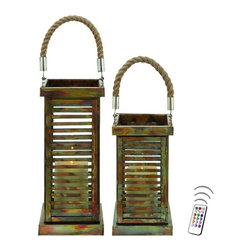 "Asian Import + USA - Antique Mission Steel Rope Lanterns with Flameless Candles - Elegantly designed tall steel Lanterns are ideal for lending a stylish, contemporary twist to a variety of decor styles. The enchanting grillwork of this lantern is a wonderful combination of mission style architecture and contemporary elegance. They have green and rust accents with an antique finish and subtle patina for added visual appeal. Medium is 7""x 22"" high; Large is 7""x 25"" high. Included are 5"" and 6"" Avion Select melted edge color wax candles with remote control timer. Note that candles pictured are for presentation only. The candles included in the set are described above. Set of 2"