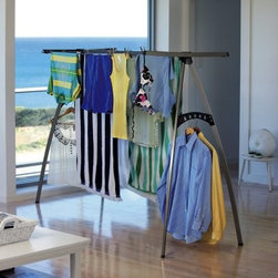 Hills Portable 120 Indoor Outdoor Clothesline - The Hills Portable 120 Indoor Outdoor Clothesline is an innovative cross between indoor drying racks and outdoor clotheslines. With space for hanger drying as well as traditional line drying, this clothesline has a spot for everything and its 39-feet of drying space is enough to hold about two loads of laundry. Fast and easy to assemble, it includes a hanging bracket for over-the-door mounting and easy storage. Fold it flat for easy carrying as you move it between the backyard and the laundry room.Please note this product does not ship to Pennsylvania.